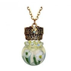 The Golden Butterfly Daisy Glass Ash Jewelry Urn are hand blown glass works of art. Each urn is made with a technique called lamp working. #cremation #jewelry