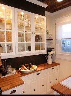 dear genevieve - this is one of my all time favorite kitchens. pressed tin backsplash painted black. I love wood/looks like wood countertops! So pretty!