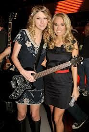 """This year has been a big year for Carrie Underwood and Taylor Swift.  2012 CMT Music Chart 1. Carrie Underwood """" Good Girl"""" 2. Taylor Swift """"Ours"""" ."""