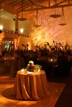 Golden Gate Club in the Presidio San Francisco, Wedding Lighting Design by Got Light. Pin spot, wedding cake, branch pattern wall wash.