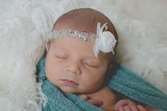 Elegant Collection.....White Headband adorned with a white rosette, delicate beaded trim and a delicate white bow and small rhinestone.  This