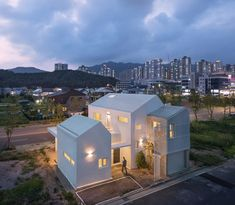 House in Yangsan combines crisp concrete and white-rendered volumes