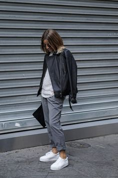 Anyone can rock the tomboy style. Camille Callen adds an androgynous edge to her look by wearing loose, boyfriend-style slacks and an oversized leather jacket. Brands Not Specified.