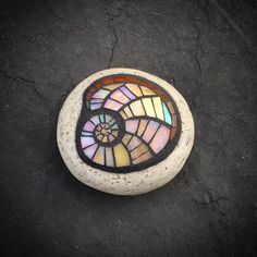 mosaic shell stone by Anne Marie Price ... could be done in large or small. Dichroic glass, or possibly iridescent shell, even cut CDs.