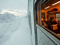 """Train Trip, Sweden    Photograph by Vytautas Serys:    """"This picture was taken in northern Sweden during a train trip to Abisko. My idea was to capture the warm train going through chilly Lapland's landscape."""""""
