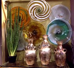Blown glass decorative wall plates that can also be placed on a table. At No Mas!  Handmade in Mexico.