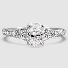 18K WHITE GOLD DUET DIAMOND RING $2,850 Diamond Oval	Carat 0.71	Color J	Cut Very Good	Clarity SI2