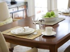 Upholstered Chairs and Wood Dining Table With Place Setting