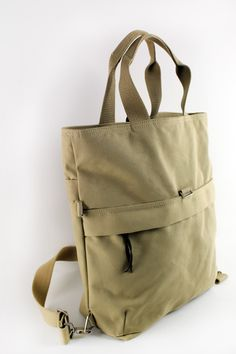 The Sal Convertible bag allows you to carry it FOUR different ways. It can covert into a briefcase, a messenger bag, a backpack and a tote bag. Comprised of heavy-duty cotton canvas for everyday use.