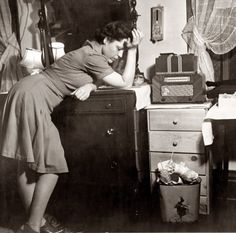 """January 1943. Washington, D.C. """"Listening to a murder mystery on the radio in a boardinghouse."""" This is one of the photos in the Ken Burns documentary """"The War,"""" with the narrator talking about people listening to war news. Photo by Esther Bubley."""