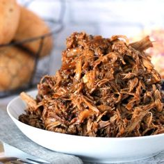 Our Favorite Slow Cooker Pulled Pork with Zesty Slaw!  This is the most tender and delicious pork you'll ever make!