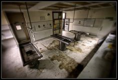 Harold Wood Hospital Morgue, Essex, UK In this unsettling image of a morgue it looks as if the medical examiners just walked out after cutting somebody open. The stains on the floor might be a mixture of organ juices, formaldehyde and other chemicals, and the water that was used to wash the body down.