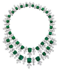 GATSBY EMERALDS This breathtaking emerald necklace contains the finest Colombian, emerald-cut, perfectly matched emeralds from the Muzo mine. This heirloom is crafted from a collection of D color, internally flawless to VVS1 pear-shaped and round diamonds.