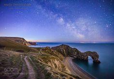 Milky Way over the famous Durdle Door in Dorset UK by Matt_Pinner
