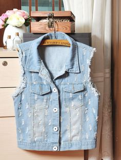 sleeveless denim jacket single breasted lapel washed white mill grinding holes in thin old waistcoat