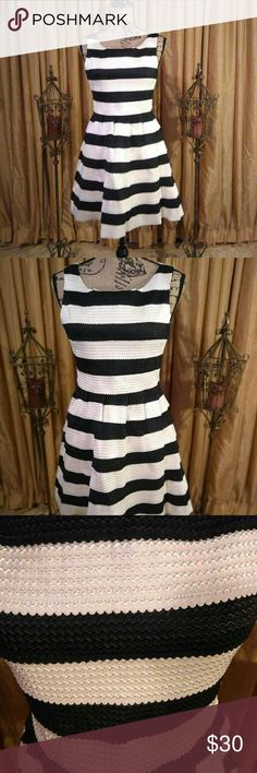 JUN&IVY Bandage Dress PRACTICALLY VINTAGE...This well made bandage dress features black and white ridges with a heavy duty zipper in the back. Fitted in bodice and flares out at bottom. Excellent condition. Message for specific details ♤ Jun&Ivy Dresses