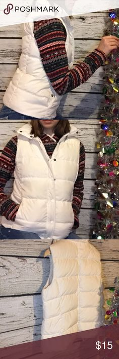 J. Crew Puffer Vest Super comfy puffer vest from J. Crew. Looks great on. Adjustable waist. Zipper and snap closure. Some pilling on inside of collar and tiny pen mark as shown. Some paint chipping off zipper. Priced accordingly. No trades. J. Crew Jackets & Coats Vests