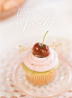 Cherry Almond Cupcakes. With a tiny bow and arrow topper. Amazing.     Photo by Heidi at http://www.whiteloftstudio.com/