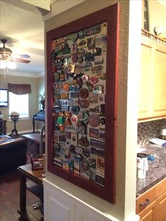 Our travel magnet board is up and it's full! Bought Sheet metal from a sheet metal company and then made a simple frame for it.