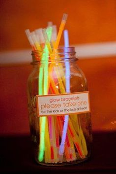 For KZ wedding- also a FAB idea for the kids table!!! GLOW BRACELETS for the little ones and GLOW NECKLACES for the older ones!