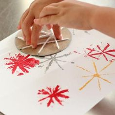 Fireworks craft - yarn around cardboard +paint