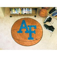 """Air Force Falcons NCAA Basketball"""" Round Floor Mat (29""""). Each Fan Mats product is produced in a 250;000 sq. ft. state-of-the art manufacturing facility. Only the highest quality; high luster yarn with 16 oz. face weight is used. These mats are chromo jet printed; allowing for unique; full penetration of the color on the machine washable non-skid Duragon latex backing with a sewn edge  - making for a beautiful and lasting piece for even the most aggressive fan.  Anything else would be…"""