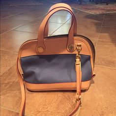 Dooney&Bourke Purse Blue and tan. Used once. In excellent condition. Dooney & Bourke Bags