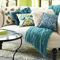 A neutral loveseat is suddenly brimming with life, thanks to some interesting blues, teals and butterflies