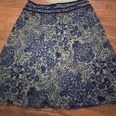 JUST MARKED DOWN Ann Taylor Skirt Sz 8 Petite Cute flowy skirt from Ann Taylor. Navy and tan floral print. Navy velvet trim at waistband. Cute tiny button closures on side. Purchased from a sample sale, so logo is marked through. Great condition. Size 8 Petite. Ann Taylor Skirts A-Line or Full