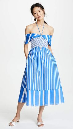 Tanya Taylor Celina Dress. Off-shoulder panels wrap around the upper arms on this striped Tanya Taylor dress, offering a soft contrast to the curve-hugging elastic bodice.