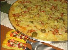 Receita de Pizza de Liquidificador - pizza (35 cm de diâmetro), untada e enfarinhada. Preparo do recheio: Em um recipiente, junte os tomates, a cebola, as azeitonas e o atum....