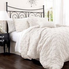 Four-piece cotton-blend comforter set with embroidered detail.  Product: Queen: Comforter, bedskirt and 2 standard shams...