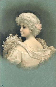 back view of girl in white dress, she looks left & holds flowers