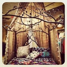 Love this canopy design. Use a round shower bar and attach curtain panels or fabric using shower curtain hooks. Then you can easily change the position of the curtains.