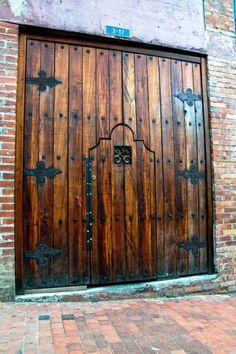Door within a door - rich wood and wrought iron by My.Life.With.Aspergers