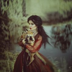 A woman and her foxes.