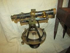 Antique W. & L.E. Gurley (Troy, NY) surveyor's transit with case and wooden tripod.
