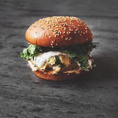 portrait of a feta red pepper turkey burger with basil tzatziki, hummus + kale // thank you @robertluessen ❤️