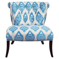 "Featuring tufted ikat-inspired upholstery, this scroll-back accent chair brings an exotic touch to your living room seating group or master suite.   Product: ChairConstruction Material: Polyester, rayon and woodColor: Blue and whiteFeatures: Scrolled backButton-tuftedDimensions: 35"" H x 32"" W x 30"" D"