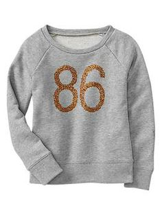 Embellished graphic pullover…my kids need this ...