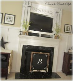 DIY: How to Enclose a Wall - Mounted TV - an easy way to frame a TV that is smaller than its recessed opening. This post shows how repurposed vinyl shutters were painted, distressed and hung above the mantel - via Down to Earth Style Tv Above Fireplace, Fireplace Mantels, Fireplaces, New Living Room, Living Room Decor, Corner Mantle, Vinyl Shutters, Framed Tv, Master Bath Remodel