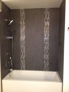 We love #emser tile! Look how amazing our display is-let us help you with your tile needs!
