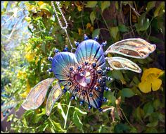 """""""Magenta Fire"""" - Winged Heart Sun-catcher. Please come check my website out at www.beadworx.com"""