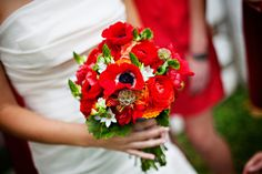 Gorgeous red bouquet, love the touches of yellow.