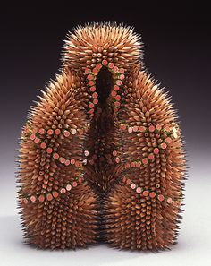 I have seen Dada works of art that have this same sort of feel to them.   Sculpture made with pencils.