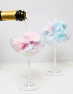 COTTON CANDY CHAMPAGNE DRINKS: Cosmopolitan.com rounded up the best ways to make fun and festive champagne cocktails for your New Year's Eve celebrations. Here you'll find clever new ways to enjoy the bubbly drink, like this cotton candy drink hack. Click through for more easy champagne and cocktail ideas and recipes you need to try!