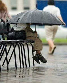 lost under an umbrella in the rain