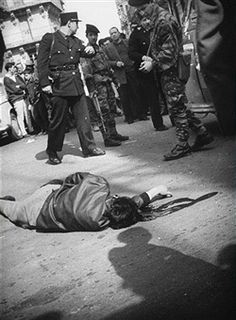 A dead man lying in the streets of Algiers. Pin by Paolo Marzioli