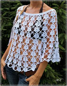 tuto Poncho crochet 5 This Lisbon Lace Poncho Free Crochet Pattern is as versatile as it is ethereal. The airy openwork design doesn't provide a lot of warmth, but it looks beautiful Blouse Au Crochet, Débardeurs Au Crochet, Crochet Cape, Crochet Poncho Patterns, Crochet Cardigan, Crochet Shawl, Crochet Pattern, Free Crochet, Crochet Stitches