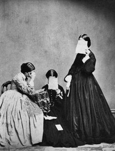 Three women in mourning poses
